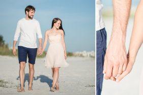 Paar geht durch die Dünen am Strand in Florida